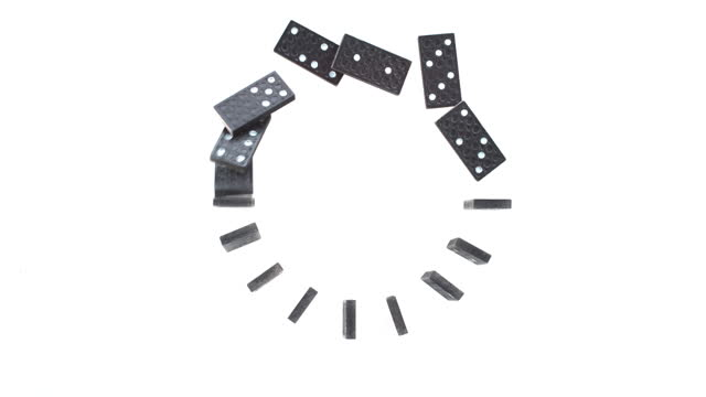 slo mo ld black dominoes set in a circle falling down on white surface - group of objects stock videos & royalty-free footage