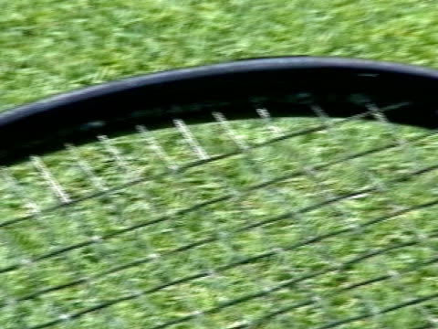 over black frame gray strings grass court under - tennis racket stock videos & royalty-free footage