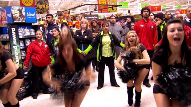 mayhem at some stores; cheerleaders cheering 'go asda' sot - black friday stock videos & royalty-free footage