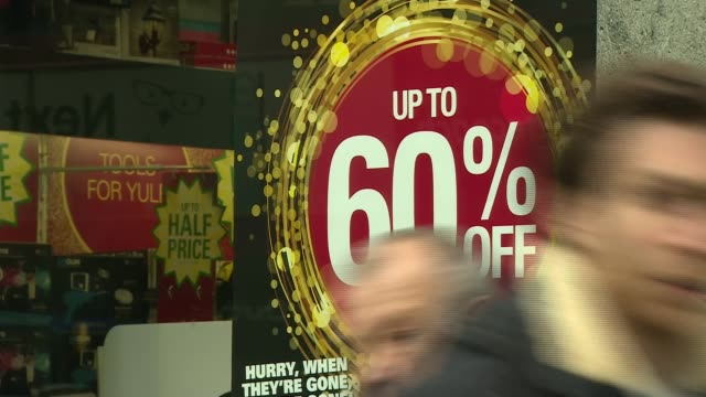 Shoppers spend as National Cyber Security Council warns of dangers of hackers ENGLAND London EXT Various of Black Friday and sales signs