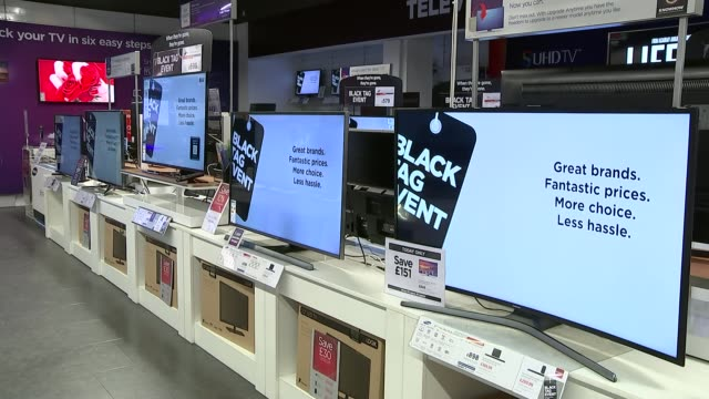 Black Friday shopping quieter than anticipated 'Black Tag Event' signs on large flat screen televisions in unidentified store/ Louise Rix interview...