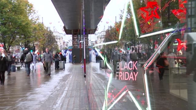 Black Friday shopping quieter than anticipated ENGLAND London Oxford Street EXT Crowd of shoppers along 'Found it on Black Friday' sign in shop...