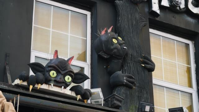black gargoyles on decorative shop front, camden - street style点の映像素材/bロール