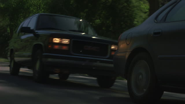 A black GMC Yukon rams into the back of a Ford Taurus during a  car chase.
