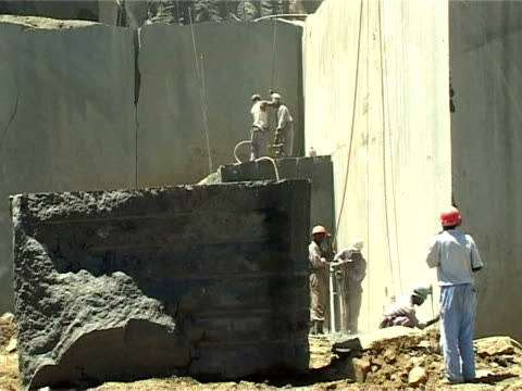 black granite from zimbabwe fetches a high price in a lucrative overseas market but in the northeast of the country where it's mined locals complain... - granite stock videos & royalty-free footage