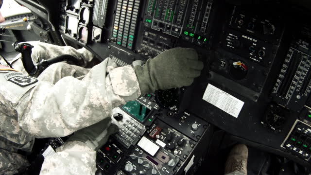black hawk copilot looking at and adjusting instruments. - luftwaffe stock-videos und b-roll-filmmaterial