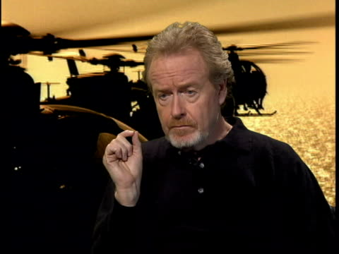 black hawk down premiere; itn ridley scott interviewed sot - totally / more intense than anything i've seen as was that way - premiere stock videos & royalty-free footage