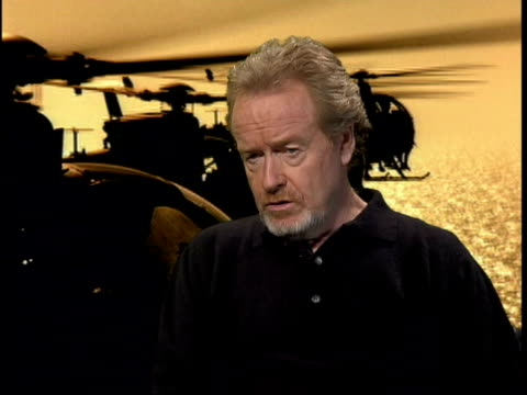 black hawk down premiere; itn ridley scott interviewed sot - you won't get any answers out of it / may walk out with lots of questions - リドリー・スコット点の映像素材/bロール