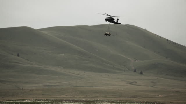 black hawk helicopter hauling a humvee - black hawk helicopter stock videos and b-roll footage