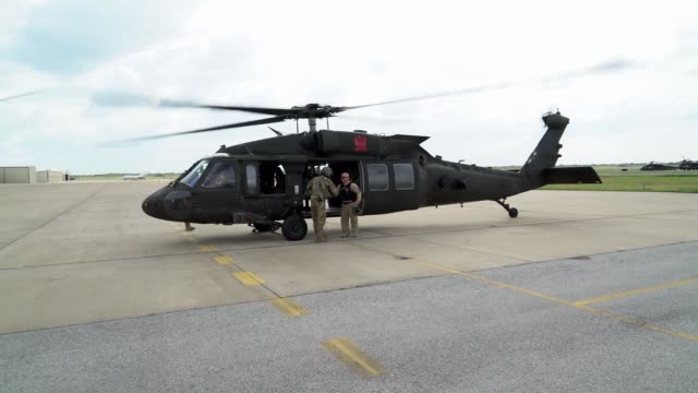 black hawk operated by the 82nd combat aviation brigade from fort bragg, north carolina conducts aerial surveillance at u.s. border port of entry at... - mcallen texas stock videos & royalty-free footage