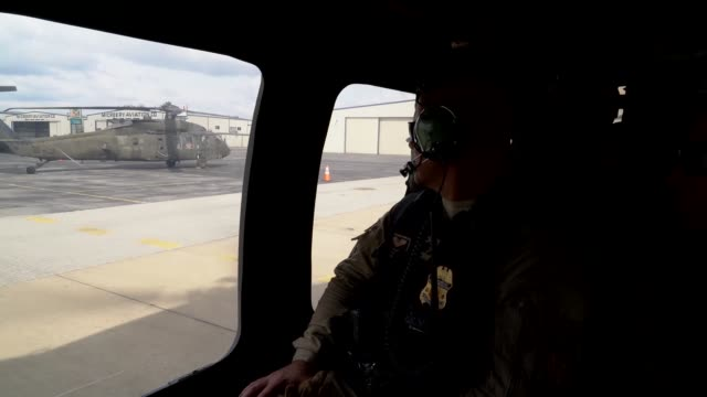 black hawk operated by the 82nd combat aviation brigade from fort bragg north carolina conducts aerial surveillance at us border port of entry at... - black hawk helicopter stock videos and b-roll footage
