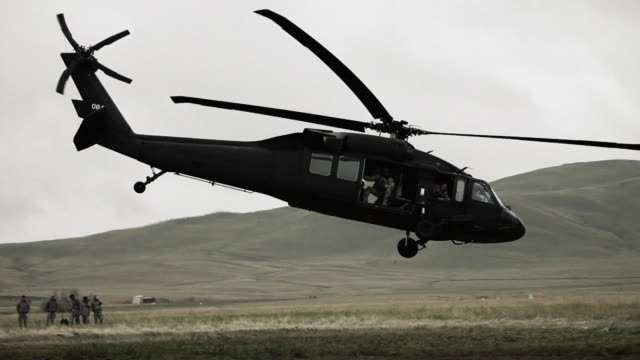 black hawk taking off. - black hawk helicopter stock videos and b-roll footage