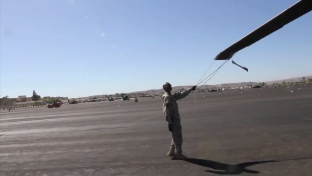 black hawks from a company 1140th aviation regiment 40th combat aviation regiment at a forward arming and refueling point camp roberts calif aircraft... - regiment stock videos and b-roll footage