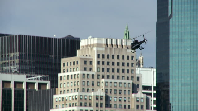a black helicopter comes in for a landing on the lower east side of manhattan. - helicopter landing stock videos & royalty-free footage