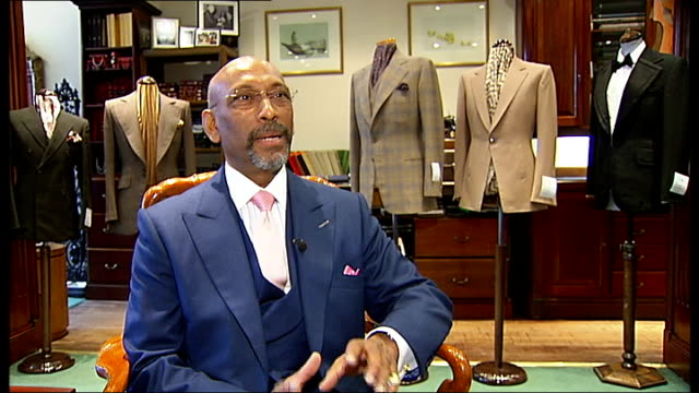 'black history month' andrew ramroop england london savile row int close shot of suit pocket lining being measured against mobile phone to make sure... - savile row stock videos and b-roll footage