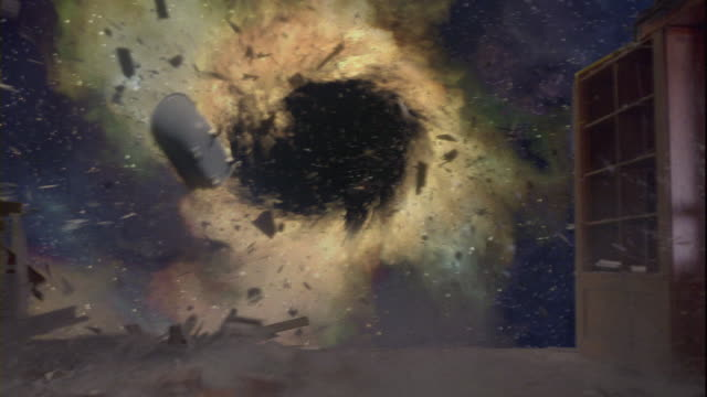 A black hole sucking debris from a damaged house in outer space.