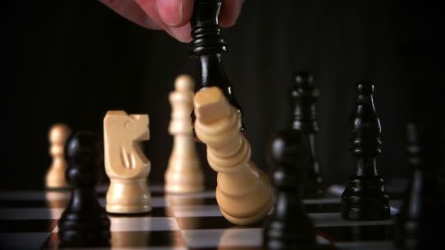 black king taking white king - part of stock videos & royalty-free footage
