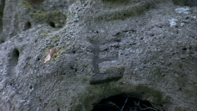 a black letter e marks a bed of gray stone on rushton triangular lodge in northamptonshire, england. available in hd. - northamptonshire stock videos & royalty-free footage