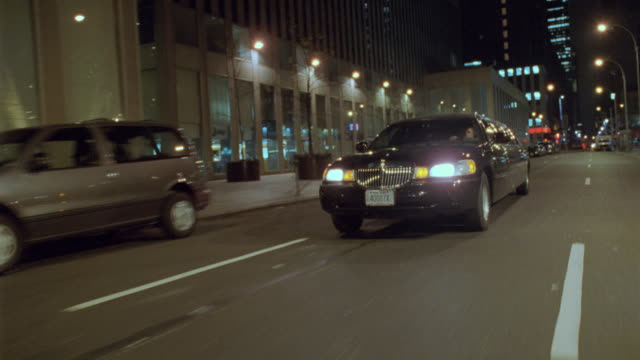 a black limousine passes down a new york city street. - western script stock videos & royalty-free footage