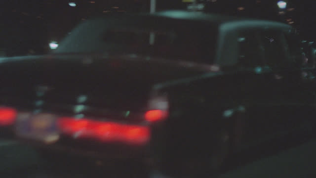black lincoln continental limo r-b on new york city street - night - limousine stock videos & royalty-free footage