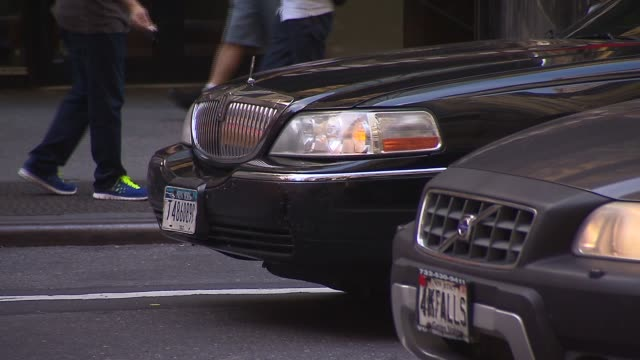 black lincoln town car on a busy city street - lincoln town car stock videos and b-roll footage