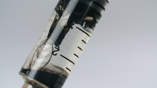 cu black liquid filling clear liquid in syringe - toxic substance stock videos & royalty-free footage