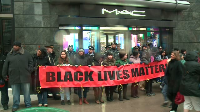 WGN Black Live Matter Protesters Block Stores on Michigan Avenue on Black Friday in the wake of the release of the video showing the shooting of...