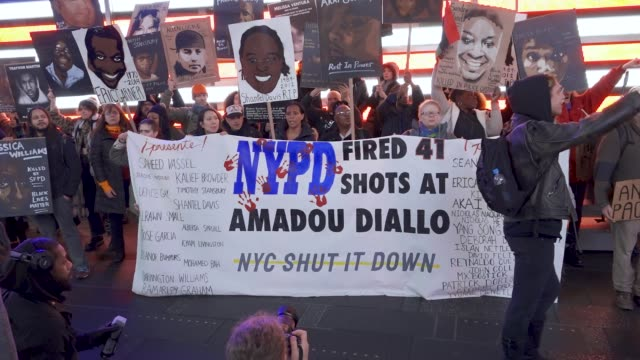 black lives matter activist rallied at grand central station and marched on the street of midtown manhattan protesting excessive police force and the... - police brutality stock videos and b-roll footage