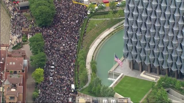 air views of protest outside us embassy; england: london: battersea: ext air view black lives matter protesters gathered in streets near to us... - aerial view stock videos & royalty-free footage