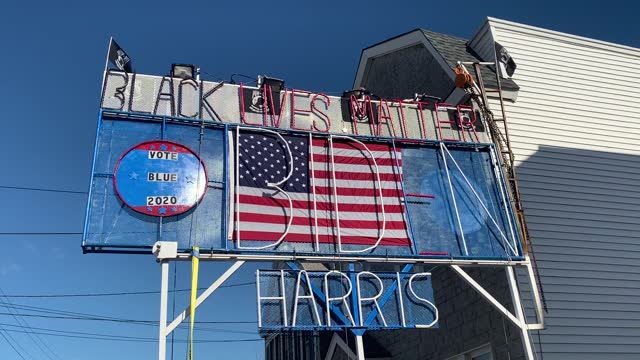 black lives matter' and 'vote for biden and harris' sign stands tall over a busy road in jersey city, new jersey on november 16, 2020. although biden... - major road stock-videos und b-roll-filmmaterial