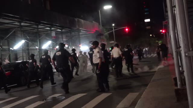black lives matter antifa 'demand amnesty black liberation' march through the nyc streets chanting 'nypd suck my dick' banner 'death to america' nypd... - anti fascism stock videos & royalty-free footage