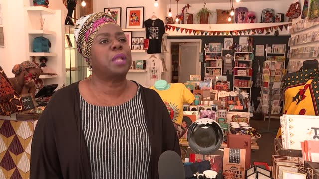 'black pound day' encouraging people to spend money on black owned businesses england london brixton ext 'electric avenue' sign 'brixton village'... - blackboard stock videos & royalty-free footage