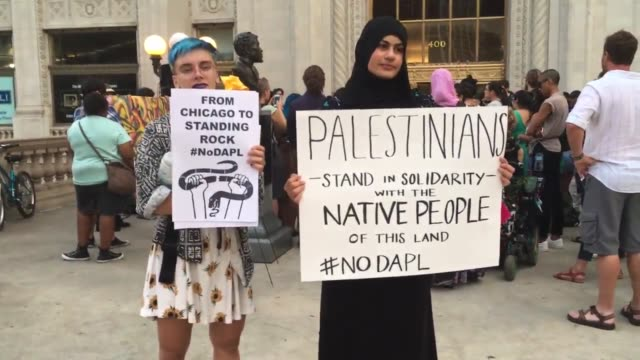 Black Lives Matter Chicago held a vigil in support of the Dakota Pipeline protesters at the Michigan Avenue Bridge Wide and medium shots of the vigil...