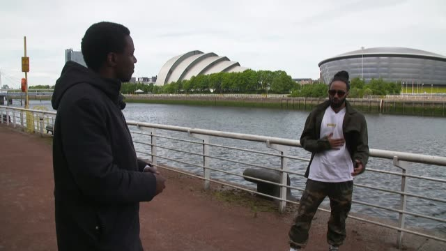 cities forced to confront racist and colonial past scotland glasgow ext barrington reeves interview sot reporter reeves standing next to river clyde - war and conflict stock-videos und b-roll-filmmaterial
