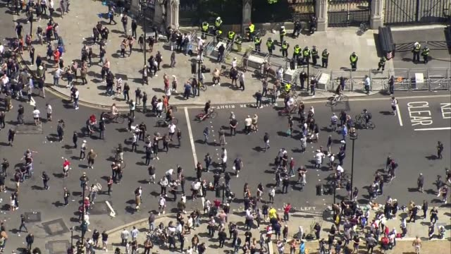 aerials protesters clashing with police in westminster england london westminster protesters gathered in parliament square / air view protesters... - war and conflict stock-videos und b-roll-filmmaterial