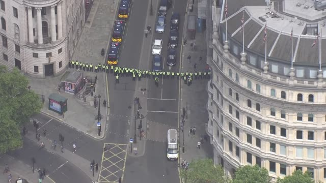 aerials protesters clashing with police in westminster england london westminster crowd of protesters around base of nelson's column / air view... - war and conflict stock-videos und b-roll-filmmaterial