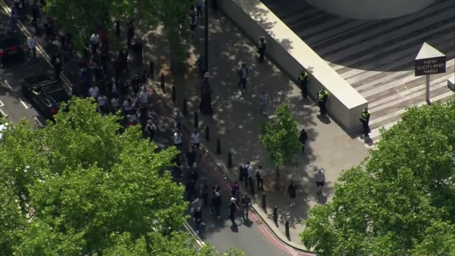 boris johnson condemns violence against police as 'racist thuggery' england london westminster far right protesters along streets air view / aerial... - war and conflict stock-videos und b-roll-filmmaterial