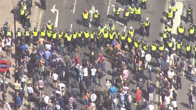 boris johnson condemns violence against police as 'racist thuggery' england london westminster counterprotesters standing off against line of riot... - war and conflict stock-videos und b-roll-filmmaterial