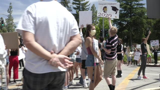black lives matter demonstration in los angeles suburb of canada. the demonstrators are mostly students who expertise their rights of a sit-in. three... - small town america stock videos & royalty-free footage