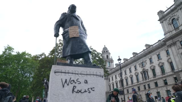 black lives matter graffiti the winston churchill statue in parliament square in london on june 7, 2020 in london, united kingdom. the death of an... - statue stock videos & royalty-free footage