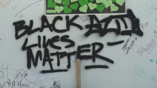 black lives matter is added to a wall where messages of support have been written, surrounding grenfell tower in west london on june 14 on the third... - surrounding wall stock-videos und b-roll-filmmaterial