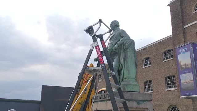london docklands statue of slave trader robert milligan removed england london isle of dogs west india docks police / people watching / placards and... - island stock videos & royalty-free footage