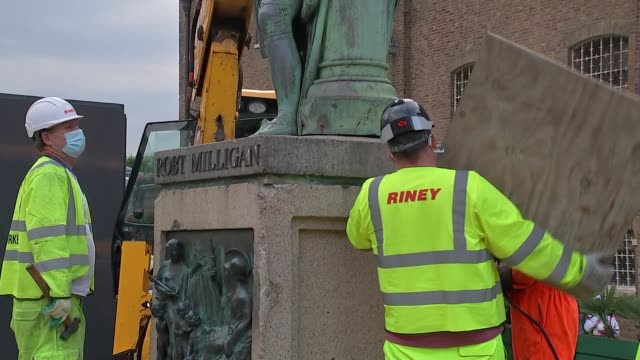 london docklands statue of slave trader robert milligan removed england london isle of dogs west india docks gvs of workmen working on base of statue - island stock videos & royalty-free footage