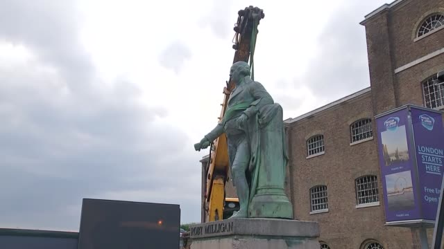 london docklands statue of slave trader robert milligan removed england london isle of dogs west india docks gvs of workmen around statue with crane - island stock videos & royalty-free footage