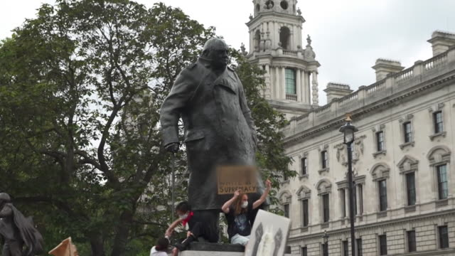 a black lives matter protest around the winston churchill statue in parliament square - anti racism stock videos & royalty-free footage