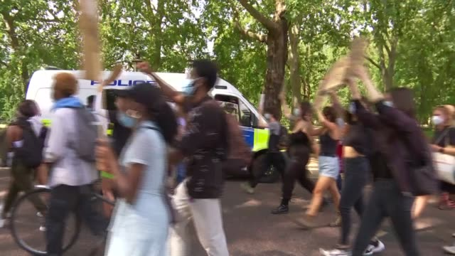 black lives matter protest march in central london; england: london: ext various of black lives matter protesters marching through london, passing... - giustizia sociale video stock e b–roll