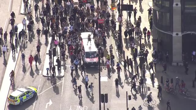 protest march through london air views england london westminster column of marching protesters extending into parliament square past foreign office... - column stock videos & royalty-free footage