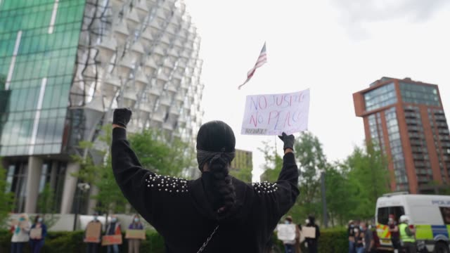 black lives matter protester hold a fist in the air outside the american embassy in london on june 7 2020 in london united kingdom the death of an... - fist stock videos & royalty-free footage