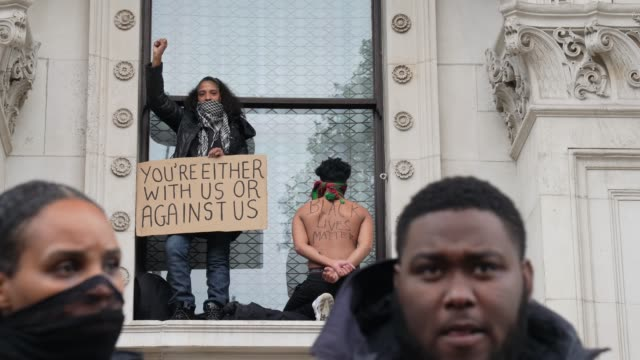 black lives matter protester hold his hand behind his back in london on june 7 2020 in london united kingdom the death of an africanamerican man... - hand stock videos & royalty-free footage