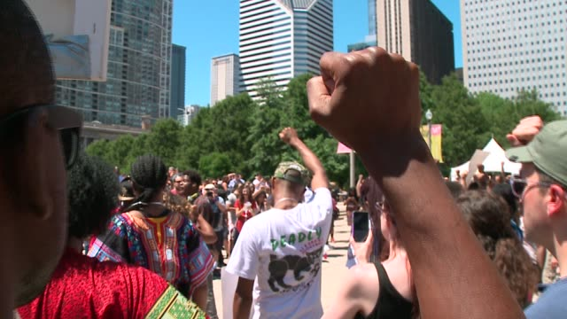 wgn black lives matter protesters in front of chicago's cloudgate bean statue in millennium park on july 9 2016 after a week that included two black... - police brutality stock videos and b-roll footage